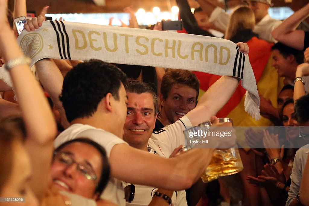 Fans celebrate Germany's 1-0 victory in 2014 FIFA World Cup final at the German beer garden Reichenbach Hall on July 13, 2014 in New York City.