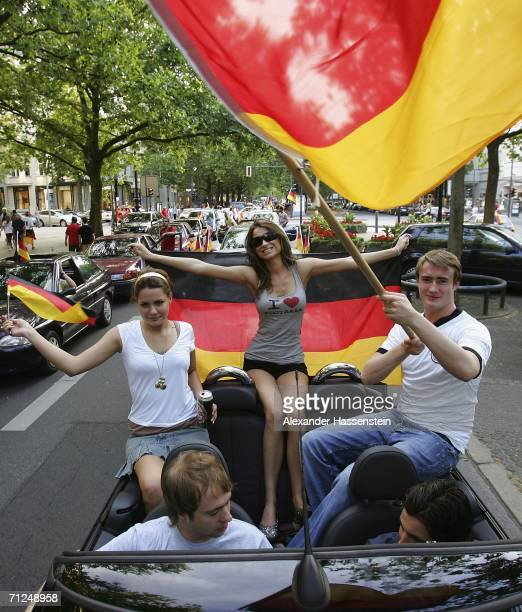 Fans celebrate Germany's win over Ecuador in the last match of the first round on Berlin's popular tourist spot Kurfuerstendamm during day 12 of the...