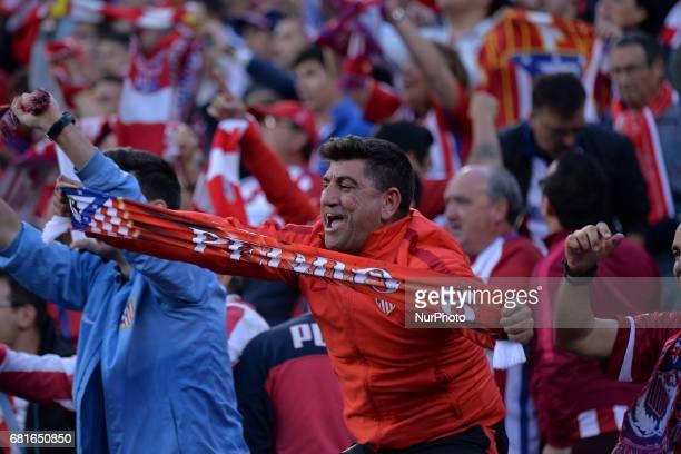 Fans celebrate Goal Griezmann during the match between Real Madrid CF vs Atletico de Madrid as part of EUFA Champions League at Estadio Santiago...