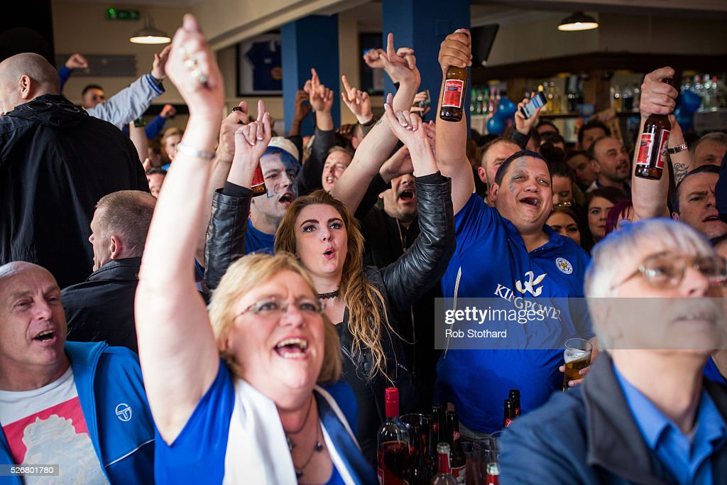 Fans celebrate in The Market Tavern after Leicester City score a goal against Manchester United on May 1st, 2016 in Leicester, England. Leicester City can win the Premier League title today if they beat Manchester United away at Old Trafford in what would be one of the league's most surprising and memoriable moments.