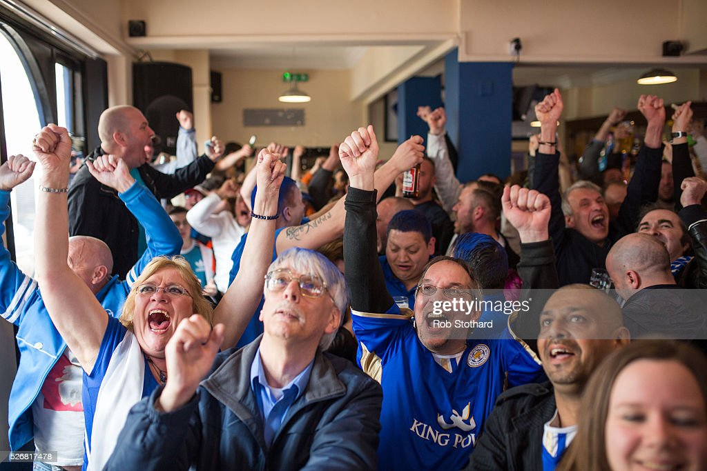 Fans celebrate in The Market Tavern after Leicester City score a goal against Manchester United on May 1, 2016 in Leicester, England. Leicester City can win the Premier League title today if they beat Manchester United away at Old Trafford in what would be one of the league's most surprising and memoriable moments.