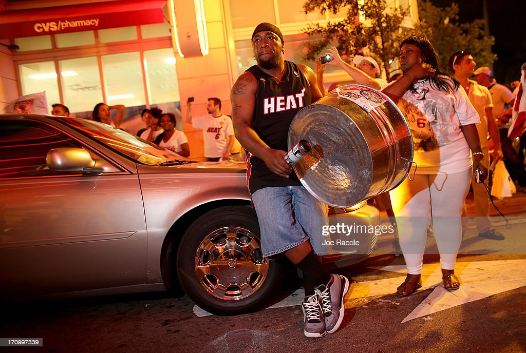 Fans celebrate in the streets after the Miami Heat won the NBA title against the San Antonio Spurs on June 20, 2013 in Miami, Florida. The Heat have won back to back championships.