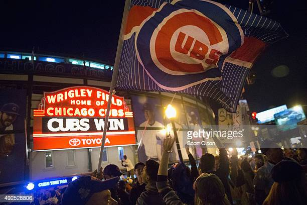 Fans celebrate outside Wrigley Field after the Chicago Cubs defeated the St Louis Cardinals to win the division championship series on October 13...