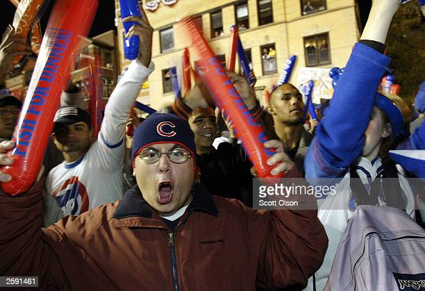 Fans celebrate outside Wrigley Field as the Chicago Cubs play the Florida Marlins in Game 6 of the National League Championship Series October 14...