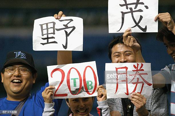 Fans celebrate the 200th win by pitcher Hideo Nomo of the Tampa Bay Devil Rays which happened to be against the Milwaukee Brewers on June 15 2005 at...