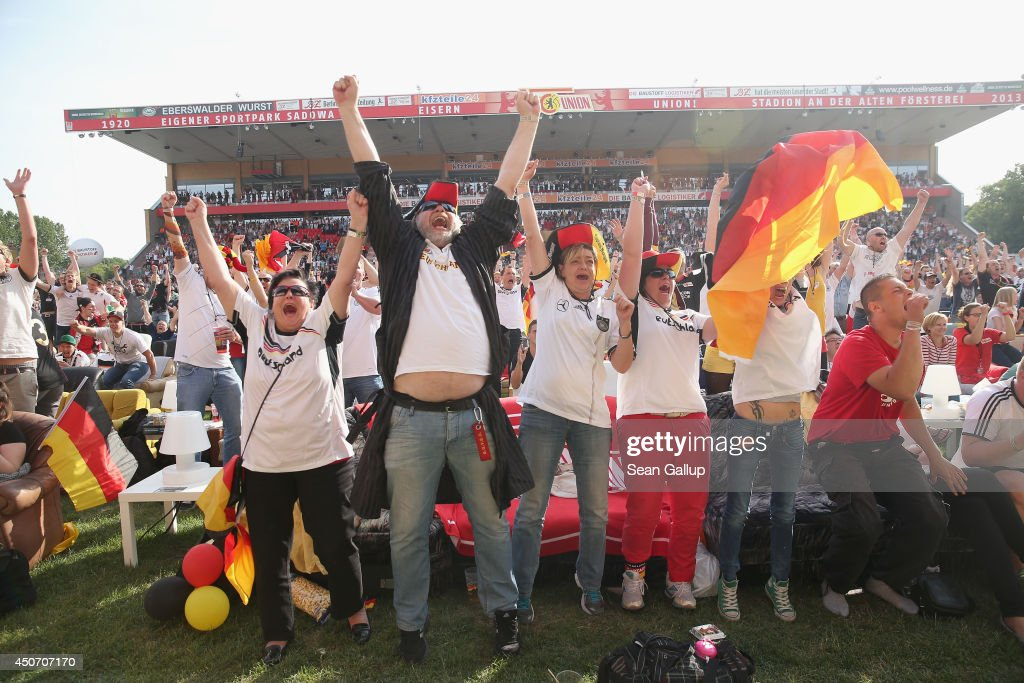Fans celebrate the first German goal during the Germany-Portugal World Cup match at a public viewing at the Alte Foersterei FC Union stadium on June 16, 2014 in Berlin, Germany. The stadium has allowed fans to bring 700 sofas that they've set up on the lawn to watch the World Cup matches on a giant monitor.
