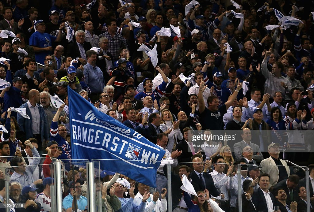 Fans celebrate the first period goal by Benoit Pouliot #67 of the New York Rangers on Jonathan Quick #32 of the Los Angeles Kings during Game Four of the 2014 NHL Stanley Cup Final at Madison Square Garden on June 11, 2014 in New York, New York.