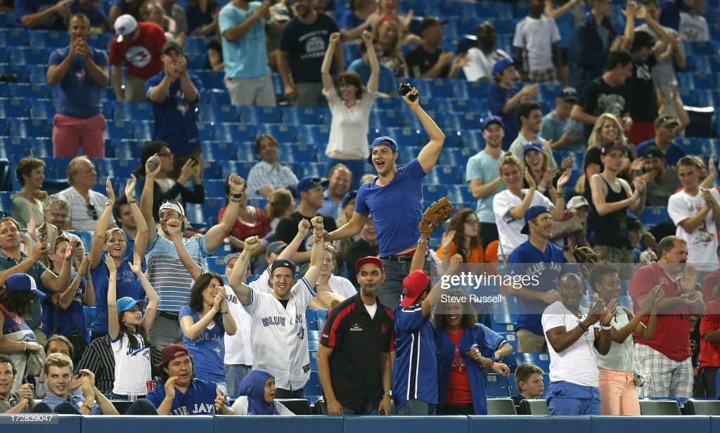 TORONTO, ON- JULY 4 - Fans celebrate the Jays breaking the shut out as the Toronto Blue Jays lose 11-1 to the Detroit Tigers at Rogers Centre.