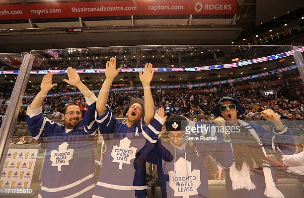 Fans celebrate the Leafs first goal as the Toronto Maple Leaf fans watch the Leafs play the Ottawa Senators in Ottawa on the scoreboard at the Air...