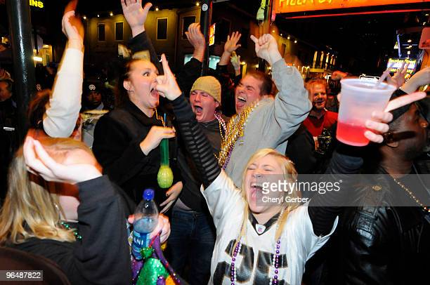Fans celebrate the New Orleans Saints win against the Indianapolis Colts during Super Bowl XLIV on Bourbon Street in the French Quarter on February 7...