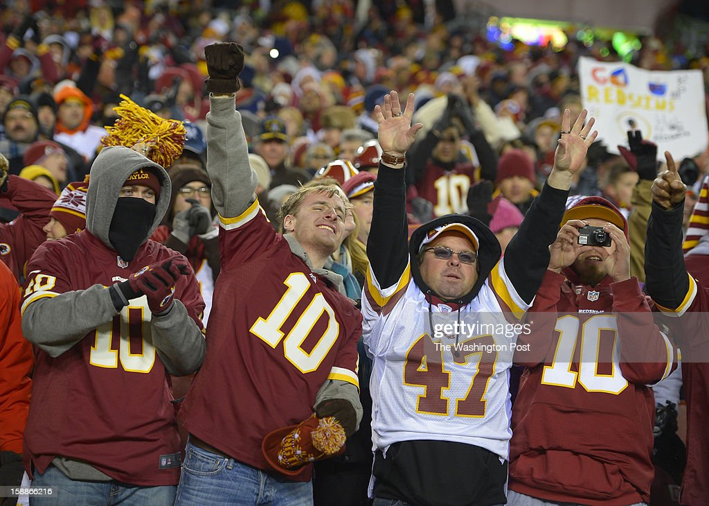 Fans celebrate the Redskins final touchdown as the Washington Redskins defeat the Dallas Cowboys 28 - 18 for first place of the NFC East division and a playoff spot at FedEx in Landover MD, December 30, 2012 .