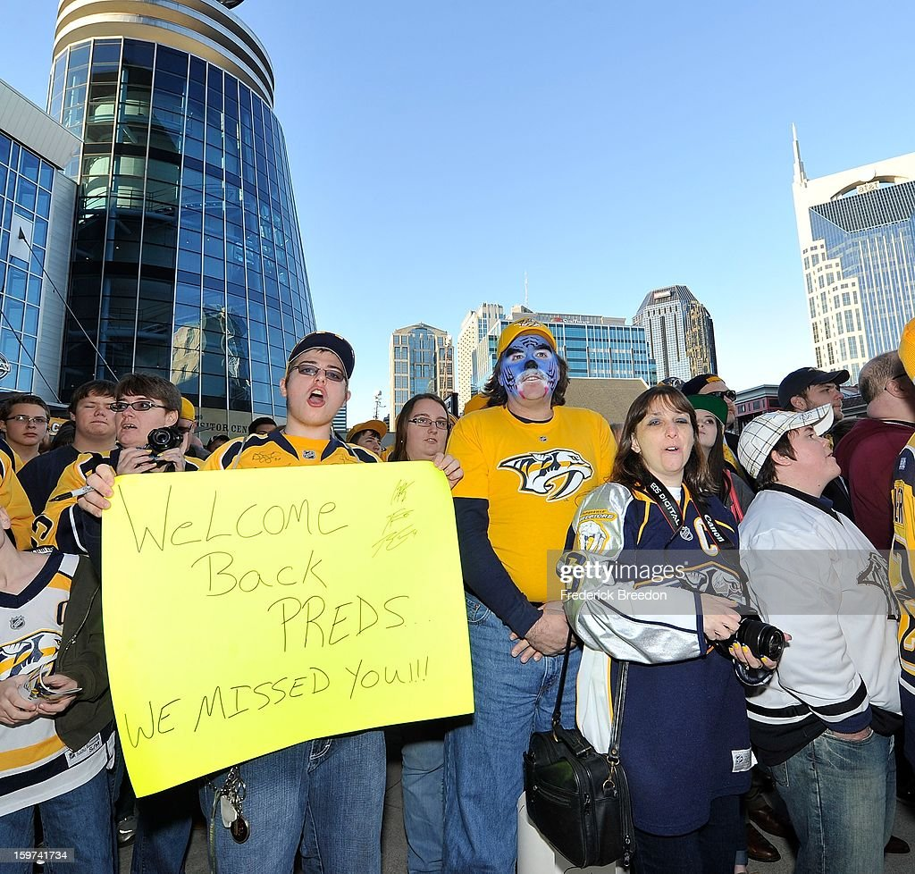 Fans celebrate the return of the Nashville Predators prior to the season opener against the Columbus Blue Jackets at Bridgestone Arena on January 19, 2013 in Nashville, Tennessee.
