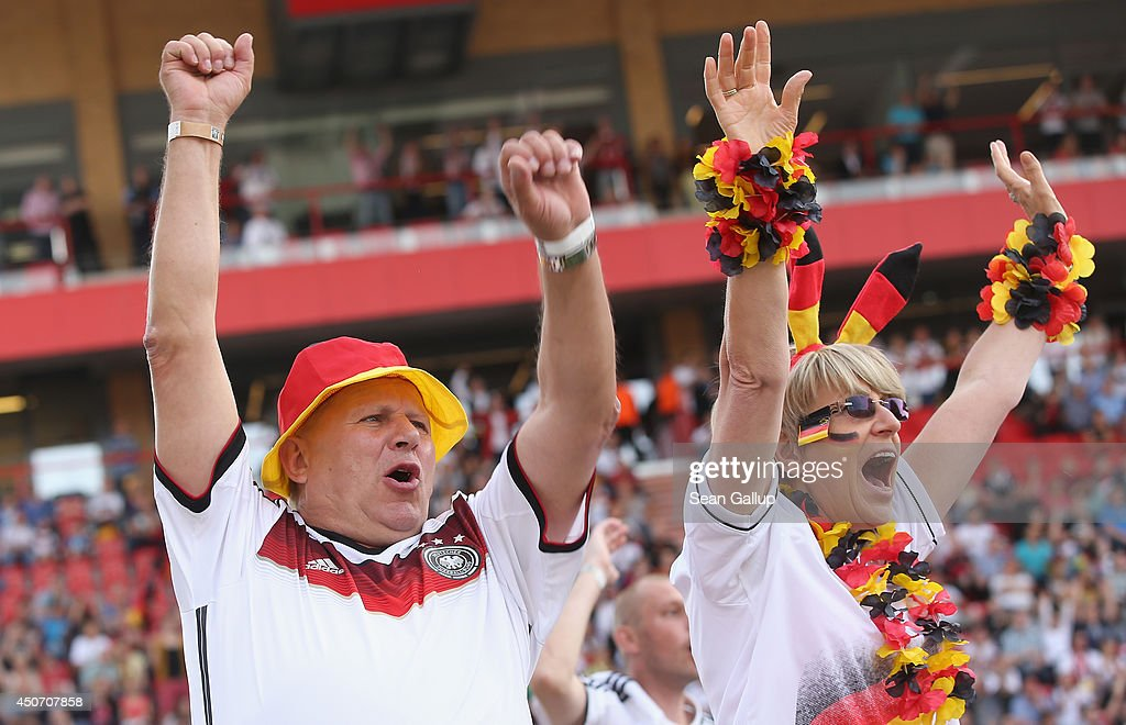 Fans celebrate the second German goal during the Germany-Portugal World Cup match at a public viewing at the Alte Foersterei FC Union stadium on June 16, 2014 in Berlin, Germany. The stadium has allowed fans to bring 700 sofas that they've set up on the lawn to watch the World Cup matches on a giant monitor.
