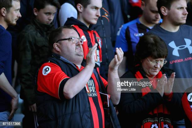 Fans celebrate victory during the Premier League match between AFC Bournemouth and Middlesbrough at the Vitality Stadium on April 22 2017 in...