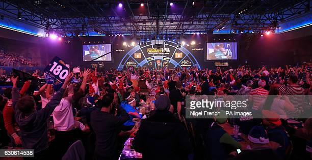 Fans celebrate watching Brendan Dolan's 180 against Jelle Klaasen during day eleven of the William Hill World Darts Championship at Alexandra Palace...