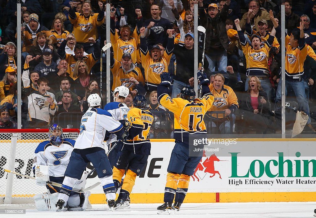 Fans celebrate with Patric Hornqvist #27 and Mike Fisher #12 of the Nashville Predators after a goal against Jaroslav Halak #41 of the St. Louis Blues during an NHL game at the Bridgestone Arena on January 21, 2013 in Nashville, Tennessee.