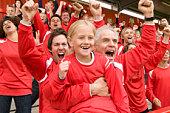 Fans celebrating at football match