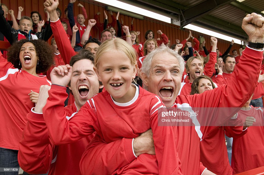 Fans celebrating at football match : Stock Photo