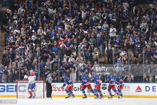 Fans cheer after a goal by Rick Nash of the New York Rangers in the second period against Carey Price of the Montreal Canadiens in Game Four of the...