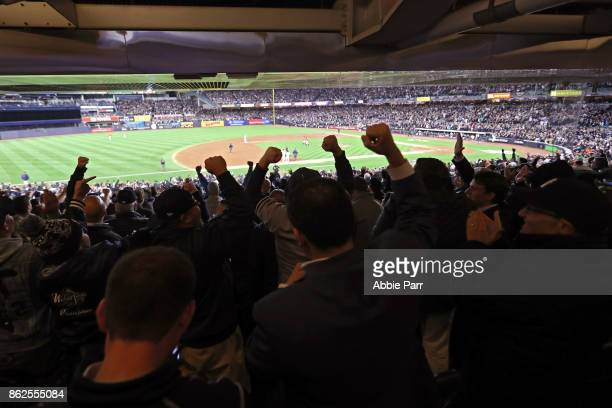 Fans cheer after a hit by the New York Yankees during the eighth inning against the Houston Astros in Game Four of the American League Championship...