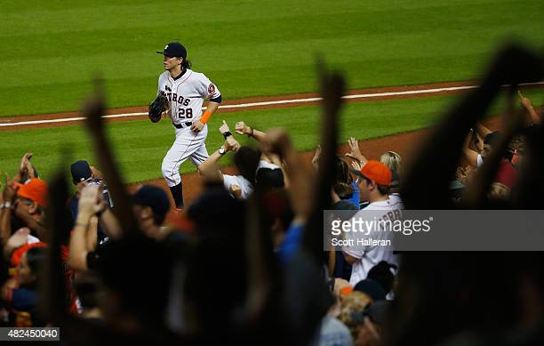 Fans cheer after Colby Rasmus of the Houston Astros made a play in right field in the sixth inning against the Los Angeles Angels of Anaheim during...