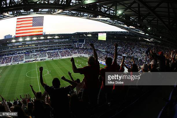 Fans cheer after Joel Lindpere of the New York Red Bulls scores in the 11th minute against the Santos FC on March 20 2010 at Red Bull Arena in...