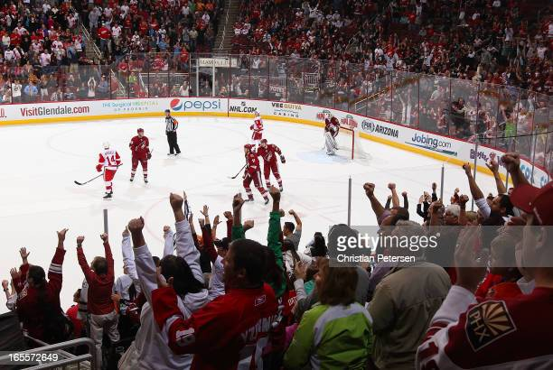 Fans cheer after Martin Hanzal of the Phoenix Coyotes scored a empty net goal against the Detroit Red Wings during the final moments of the NHL game...