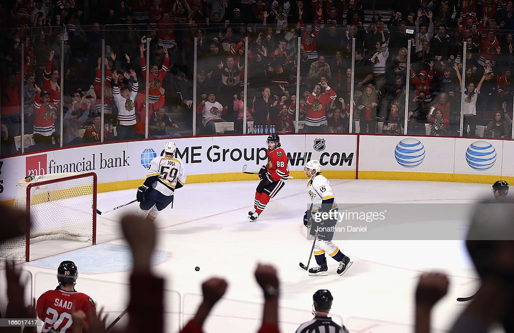 Fans cheer after Patrick Kane #88 of the Chicago Blackhawks scores an empty net goal as <a gi-track='captionPersonalityLinkClicked' href=/galleries/search?phrase=Roman+Josi&family=editorial&specificpeople=4247871 ng-click='$event.stopPropagation()'>Roman Josi</a> #59 (L) and Craig Smith #15 of the Nashville Predators try to defend at the United Center on April 7, 2013 in Chicago, Illinois. The Blackhawks defeated the Predators 5-3.