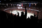Fans cheer after the Calgary Flames score against the Anaheim Ducks at Scotiabank Saddledome for Game Four of the Western Quarterfinals during the...
