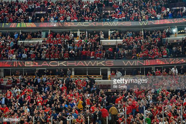 Fans cheer after the Chicago Blackhawks defeated the Ottawa Senators 65 during the NHL game on October 29 2013 at the United Center in Chicago...