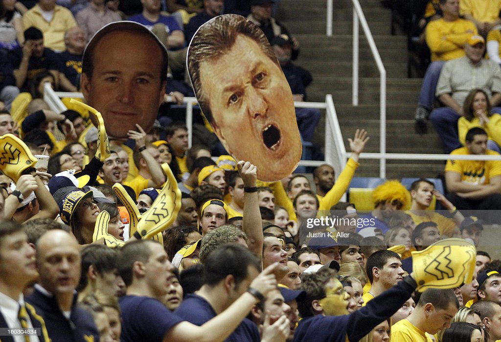 WVU fans cheer against the Kansas Jayhawks at the WVU Coliseum on January 28, 2013 in Morgantown, West Virginia. The Jayhawks defeated WVU 61-56.