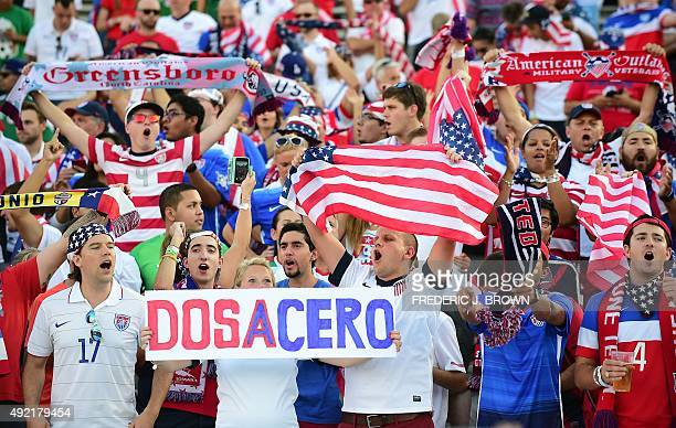 US fans cheer ahead of kickoff for their 2015 CONCACAF Cup match against Mexico at the Rose Bowl in Pasadena California on October 10 a playoff for...
