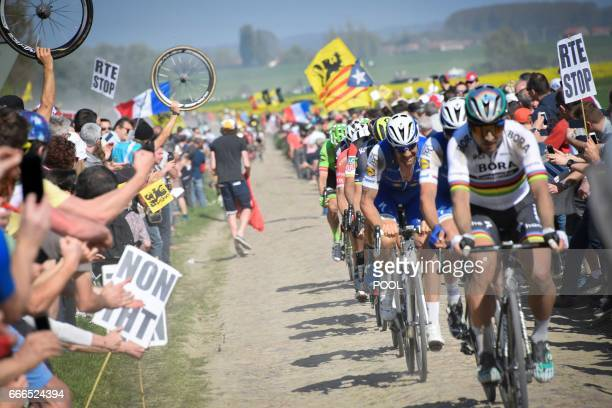 Fans cheer along the road as riders including Slovakia's Peter Sagan rides on the cobblestones during the 115th edition of the ParisRoubaix oneday...