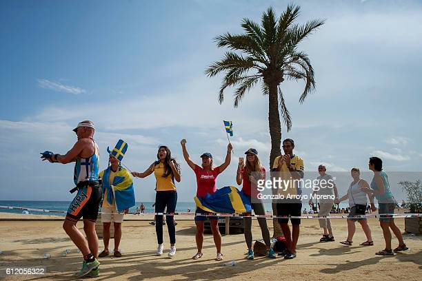 Fans cheer an athlete competing during the running course of the Ironman Barcelona on October 2 2016 in Calella Spain