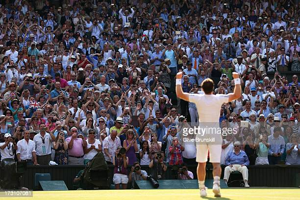 Fans cheer and take photographs as Andy Murray of Great Britain celebrates victory in the Gentlemen's Singles Final match against Novak Djokovic of...
