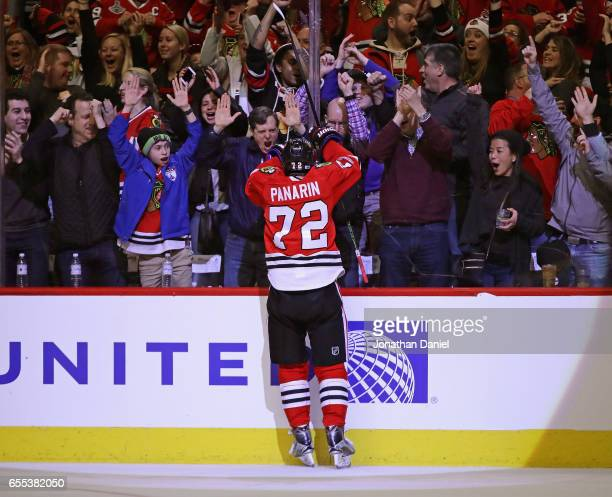 Fans cheer as Artemi Panarin of the Chicago Blackhawks celebrates a third period goal against the Colorado Avalanche at the United Center on March 19...