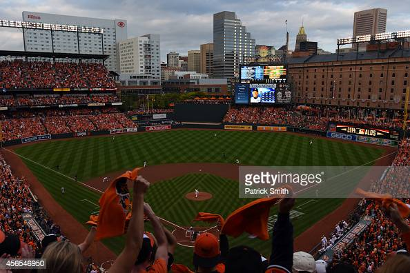Fans cheer as Chris Tillman of the Baltimore Orioles throws a pitch in the first inning against the Detroit Tigers during Game One of the American...