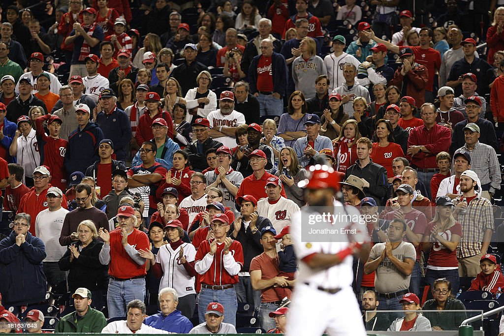 Fans cheer as Denard Span #2 of the Washington Nationals bats with the bases loaded against the Miami Marlins during the fourth inning in game 2 of their day-night doubleheader at Nationals Park on September 22, 2013 in Washington, DC.