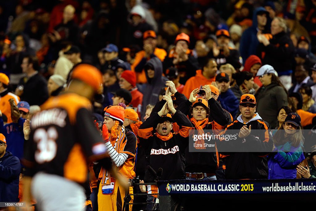 Fans cheer as Diegomar Markwell #36 of the Netherlands comes out of the game in the fifth inning against the Dominican Republic during the semifinal of the World Baseball Classic at AT&T Park on March 18, 2013 in San Francisco, California.