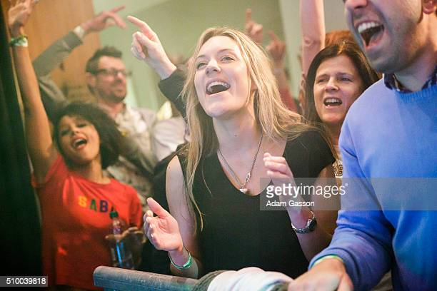 Fans cheer as DJ Krust and Roni Size perform on the second day of the BBC 6 Music Festival at Colston Hall on February 13 2016 in Bristol England
