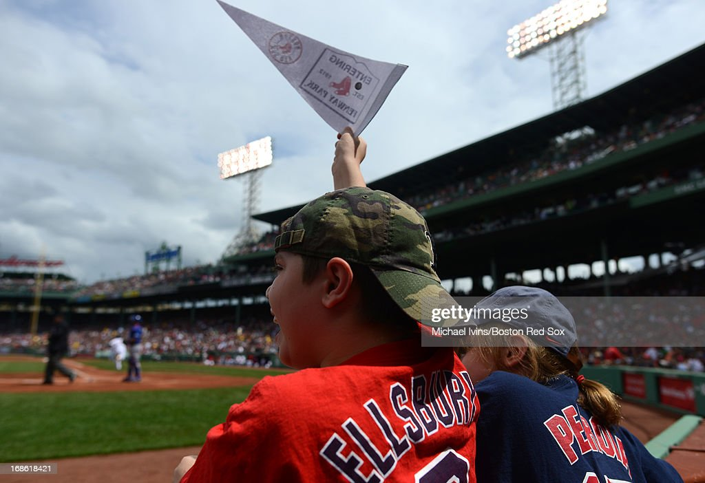 Fans cheer as Dustin Pedroia #15 of the Boston Red Sox gets a hit against the Toronto Blue Jays in the first inning on May 12, 2013 at Fenway Park in Boston, Massachusetts.