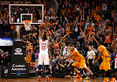 Fans cheer as James Harden of the Houston Rockets takes a free throw shot during the NBA game against the Phoenix Suns at US Airways Center on...