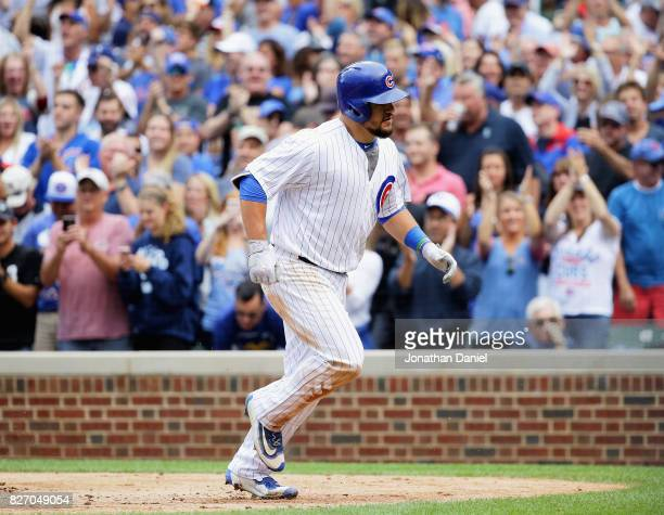 Fans cheer as Kyle Schwarber of the Chicago Cubs runs to the dugout after hitting a solo home run in the 6th inning against the Washington Nationals...