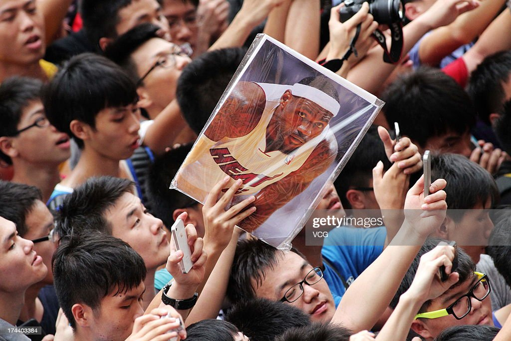 Fans cheer as LeBron James of the Miami Heat visits a Nike store on July 25, 2013 in Guangzhou, China.