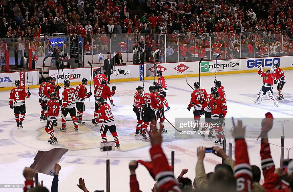 Fans cheer as members of the Chicago Blackhawks salute the crowd after a win over the Minnesota Wild in Game Two of the Second Round of the 2014 NHL Stanley Cup Playoffs at the United Center on May 4, 2014 in Chicago, Illinois. The Blackhawks defeated the Wild 4-1.