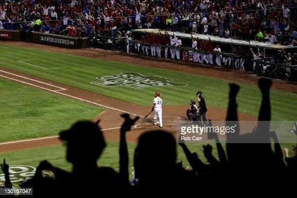 Fans cheer as Mike Napoli of the Texas Rangers hits a threerun home run in the sixth inning during Game Four of the MLB World Series against the St...