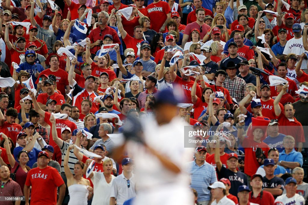 Fans cheer as <a gi-track='captionPersonalityLinkClicked' href=/galleries/search?phrase=Neftali+Feliz&family=editorial&specificpeople=5753005 ng-click='$event.stopPropagation()'>Neftali Feliz</a> #30 of the Texas Rangers pitches against the New York Yankees in Game Two of the ALCS during the 2010 MLB Playoffs at Rangers Ballpark in Arlington on October 16, 2010 in Arlington, Texas.