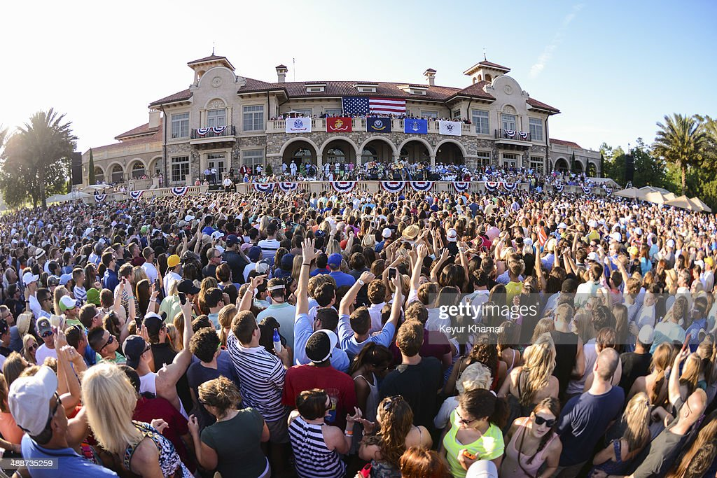 Fans cheer as recording artist <a gi-track='captionPersonalityLinkClicked' href=/galleries/search?phrase=Jake+Owen&family=editorial&specificpeople=619166 ng-click='$event.stopPropagation()'>Jake Owen</a> performs in concert during THE PLAYERS Championship Military Appreciation Day Ceremony outside the TPC Sawgrass clubhouse on May 7, 2014 in Ponte Vedra Beach, Florida.