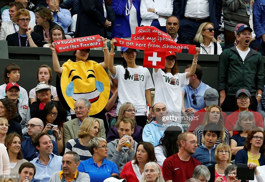 Fans cheer as Roger Federer of Switzerland plays against Marcus Willis of Great Britain in the men's singles on day three of the 2016 Wimbledon Championships at the All England Lawn and Croquet Club in London, United Kingdom on June 29 2016.