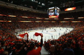 Fans cheer as the Anaheim Ducks come on to the ice prior to the start of Game One of the First Round of the 2014 NHL Stanley Cup Playoffs against the...
